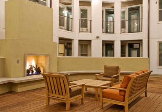 Pool area lounge at The Monterey by Windsor Apartments in Dallas TX