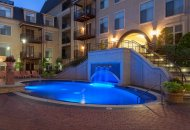 Nighttime view of hot tub at Trianon by Windsor Apartments in Dallas TX
