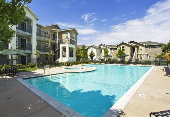 Outdoor swimming pool at The Kensington Apartment Homes in Plesanton CA