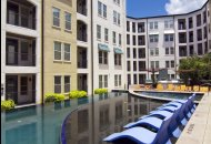 Outdoor swimming pool at The Monterey by Windsor Apartments in Dallas TX