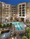 View of pool and buildings at Windsor at Brookhaven Apartments in Atlanta GA