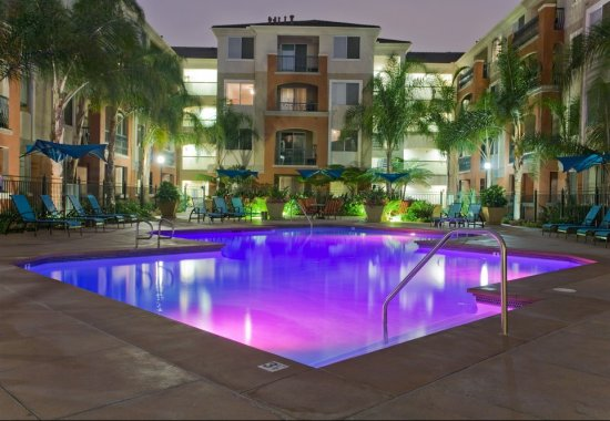 Nighttime view of pool at Windsor at Main Place Apartments in Orange CA