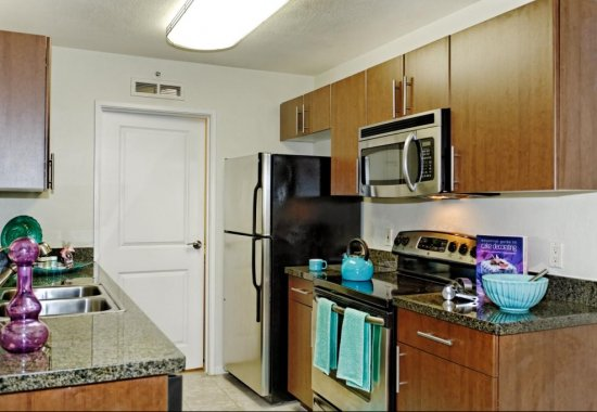 View of model kitchen at Mission Pointe by Windsor Apartments in Sunnyvale CA