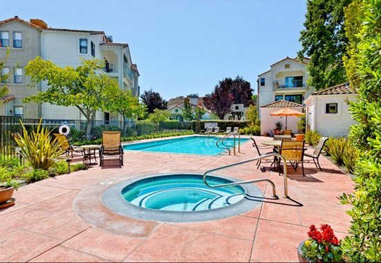 Outdoor swimming pool at Mission Pointe by Windsor Apartments in Sunnyvale CA