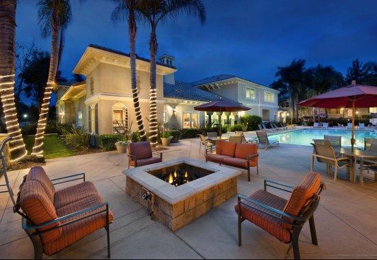 Pool area after dark at Windsor at Aviara Apartments in Carlsbad CA