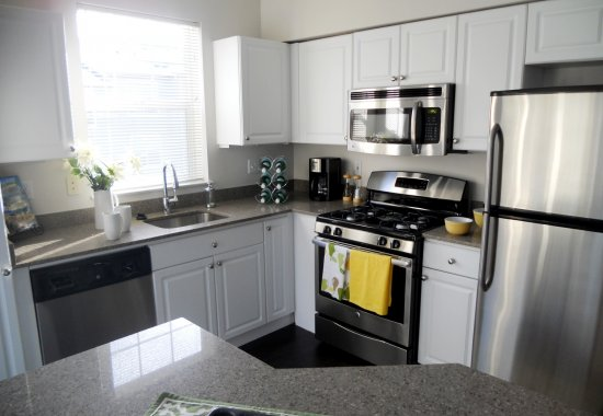 View of model kitchen at Estates at Cougar Mountain Apartments in Issaquah WA