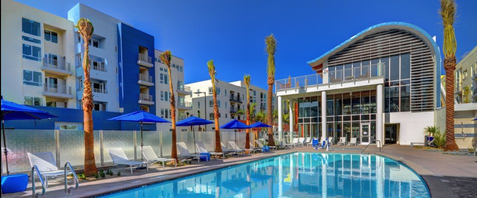 View of resort-style pool at Boardwalk by Windsor Apartments in Huntington Beach CA