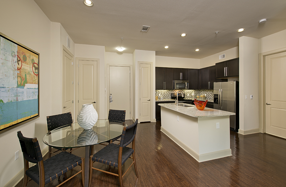 Kitchen and dining area at Domain by Windsor Apartments in Houston TX