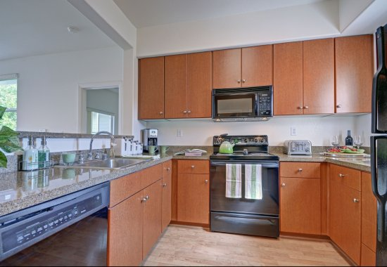 View of model kitchen at The Kensington Apartment Homes in Plesanton CA