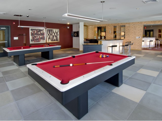 Image of Billiards room with foosball table, pub-style seating and flat-screen TV\'s for Windsor at Contee Crossing