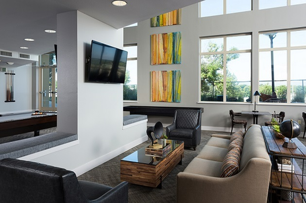 View of game room at The District by Windsor Apartments in Denver CO