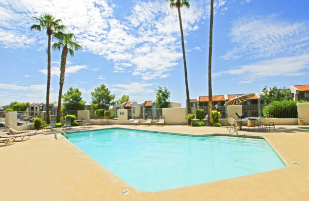 Live in walking distance to the Rillito River Walk and just minutes from downtown