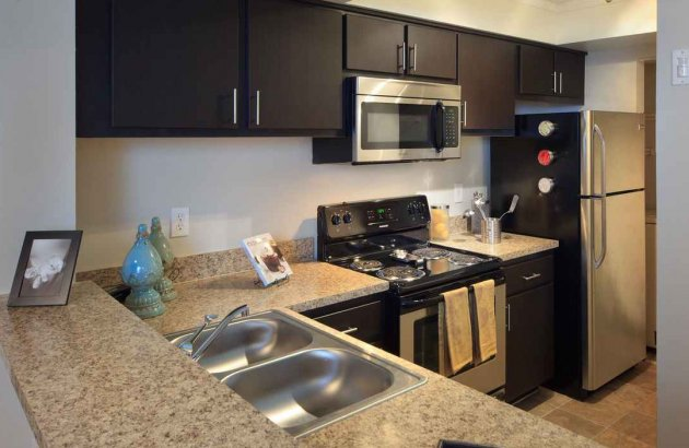 Handsome stainless steel appliances are available in select homes