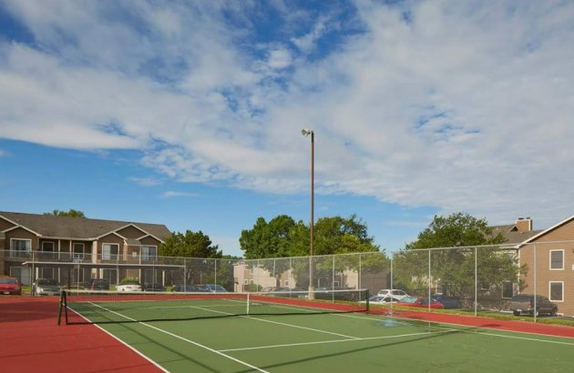 Join your neighbors or friends for a friendly game on the community tennis court