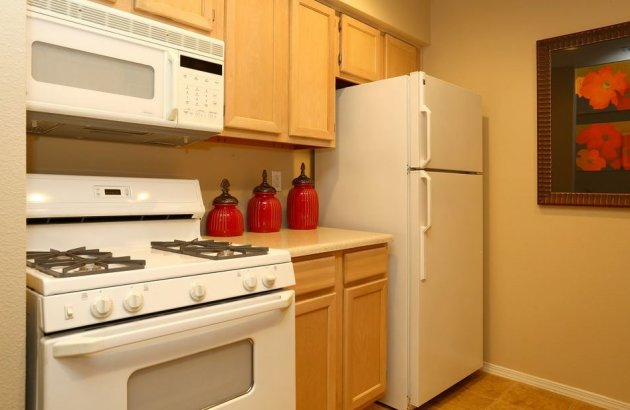 Enjoy cooking meals in your kitchen complete with a gas range, microwave, refrigerator and dishwasher