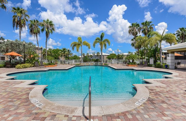Enjoy a sunny day or warm afternoon by the community's sparkling pool and sun-drenched deck