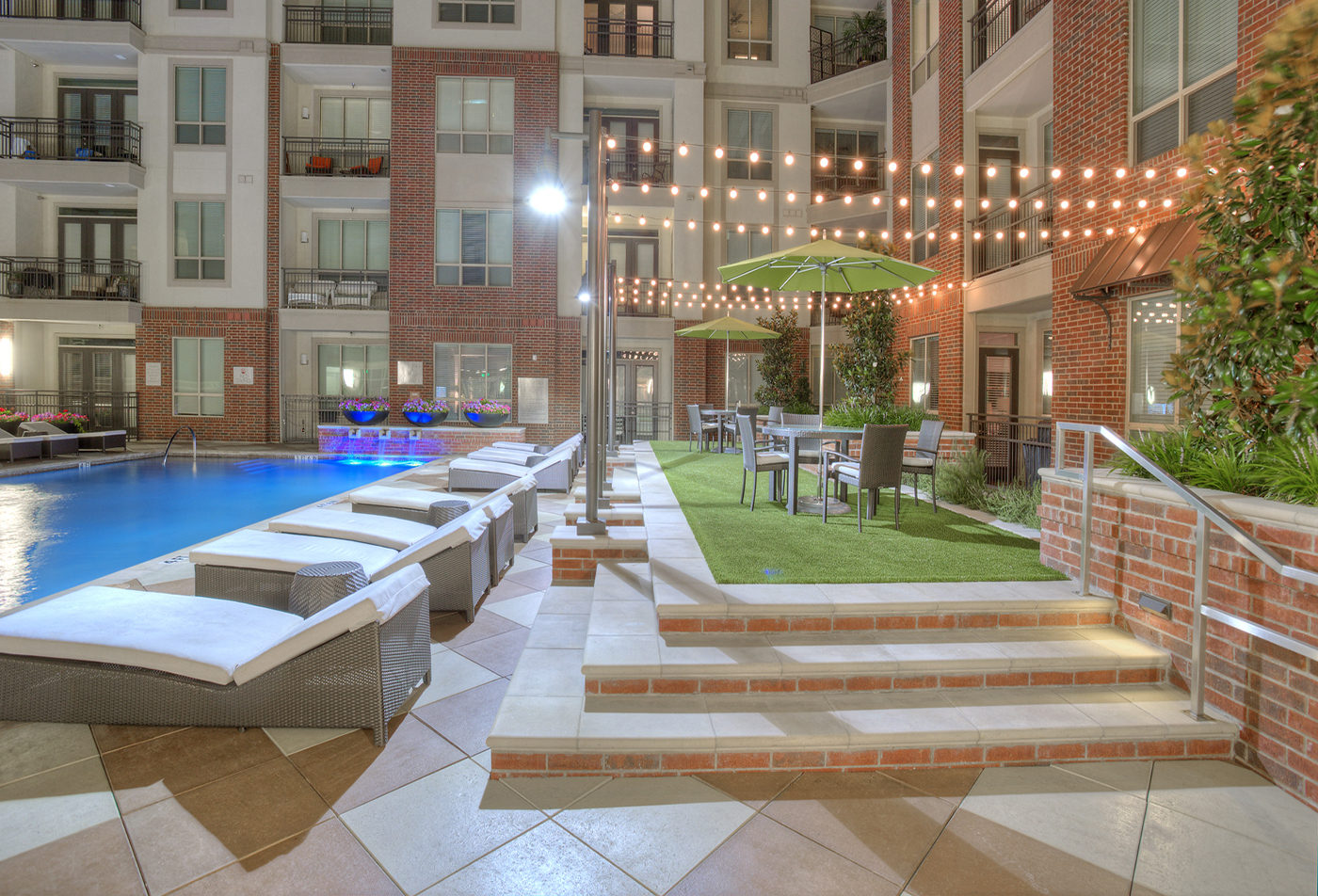 ALARA Uptown | Dallas TX rentals | Beautiful night view of the pool