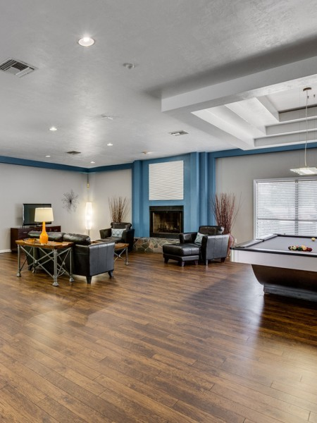 community clubhouse with pool table, seating area, fireplace and a TV