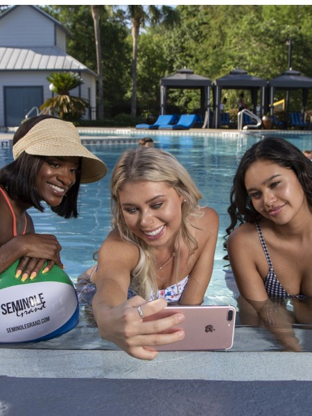 3 girls in pool taking selfie