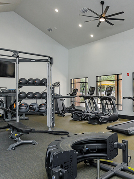 Fitness center with cardio equipment and free weights.