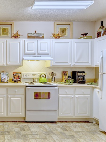 View of the Kitchen at Summer Park Apartments, Showing Cabinets and Gas Appliances