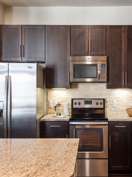 View of the Kitchen at 3800 Main Apartments, Showing Island and Stainless Steel Appliances