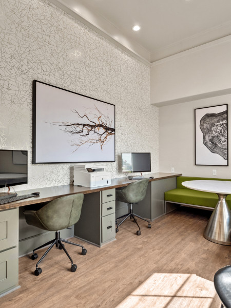 View of the Business Center at Retreat at Stafford showing work spaces with computer desk tops.