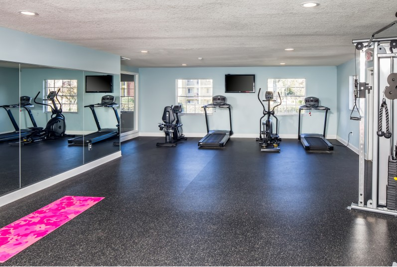 fitness center, workout equipment, mirrored wall