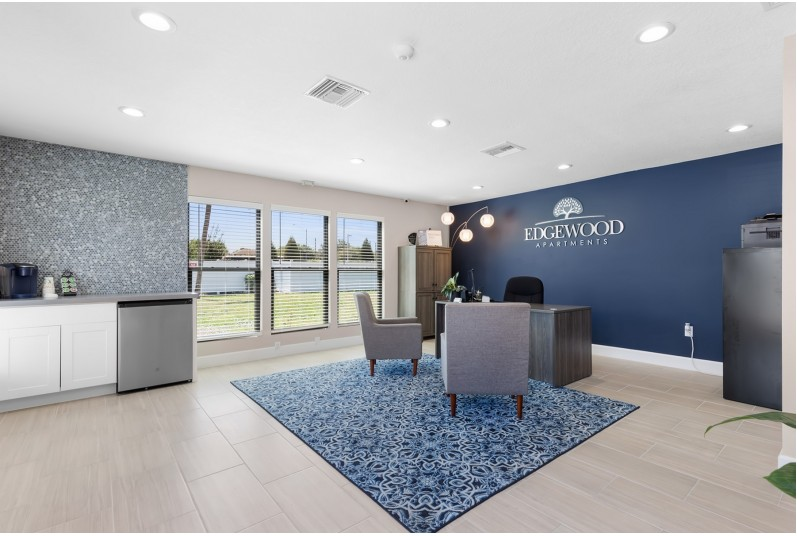 Leasing Office,  chairs, desk, rug, windows