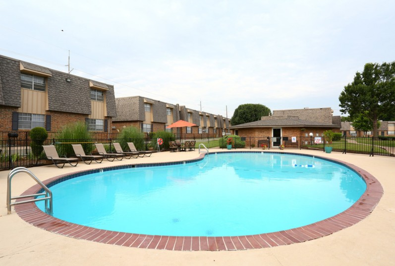 exterior photo of on site swimming pool and exterior buildings