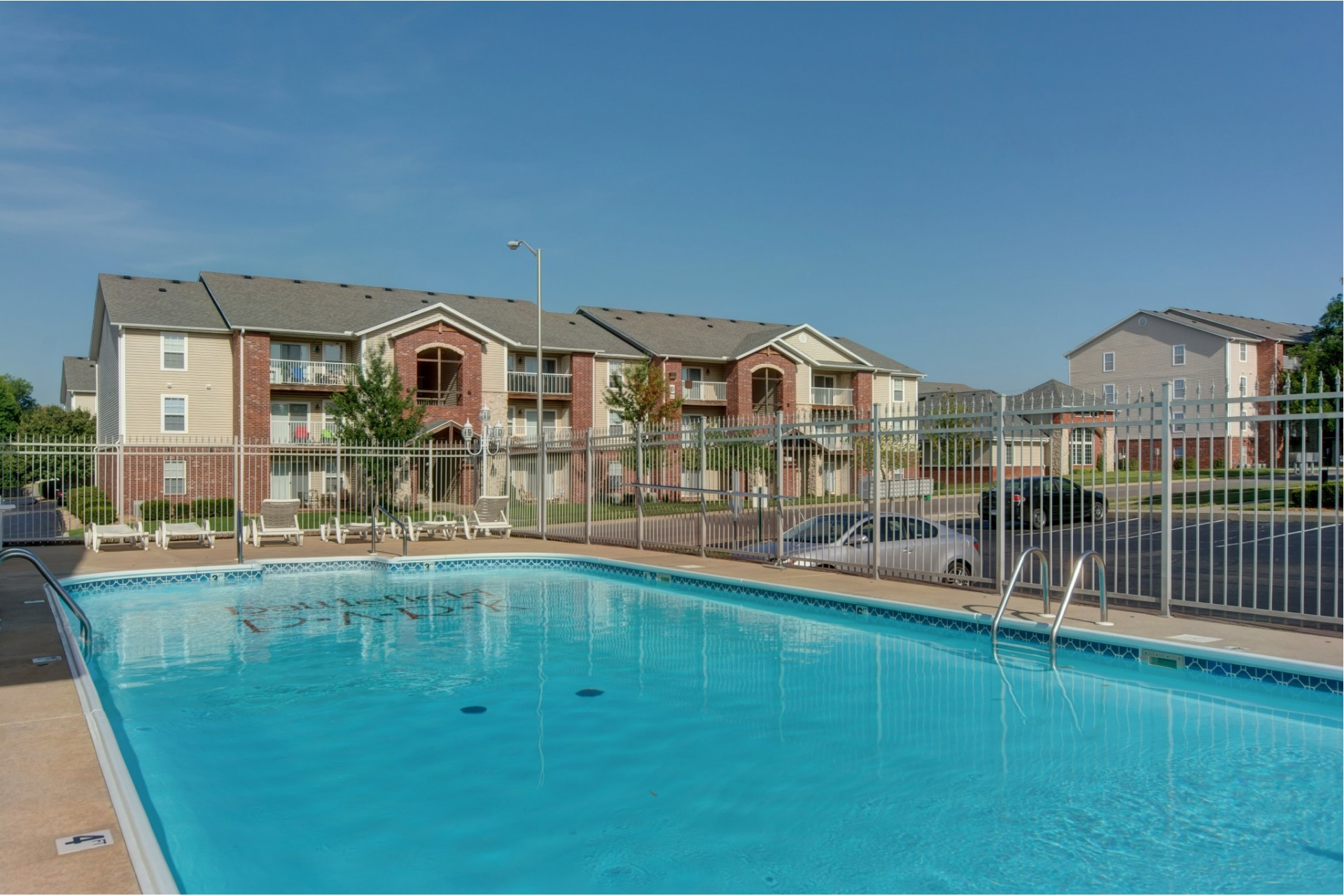 outdoor swimming pool and exterior apartment buildings at Battlefield Park