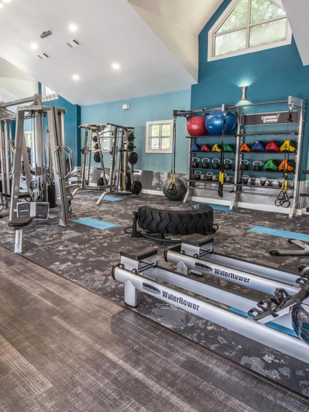 fully equipped gym with weight lifting and exercise machines
