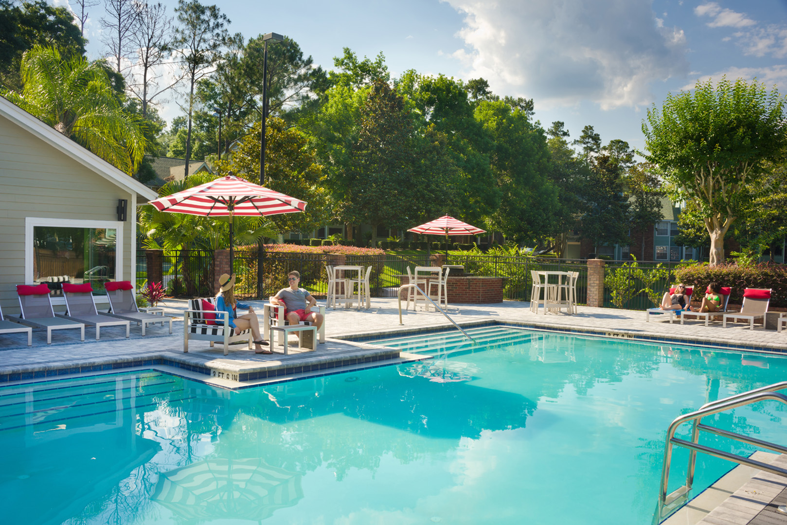 Sparkling pool, with poolside grill and sundeck.