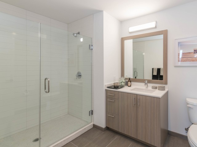 Image of Spacious Showers With Glass Enclosure for Eleven 40