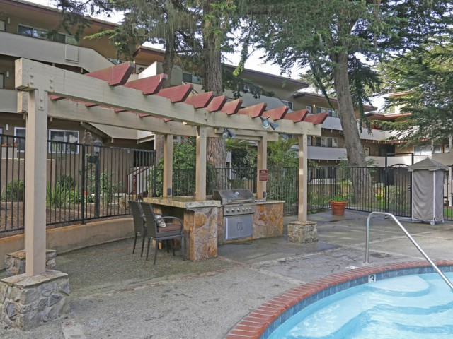 Image of Poolside BBQ area with gas grill for The Crest at Pacific Grove