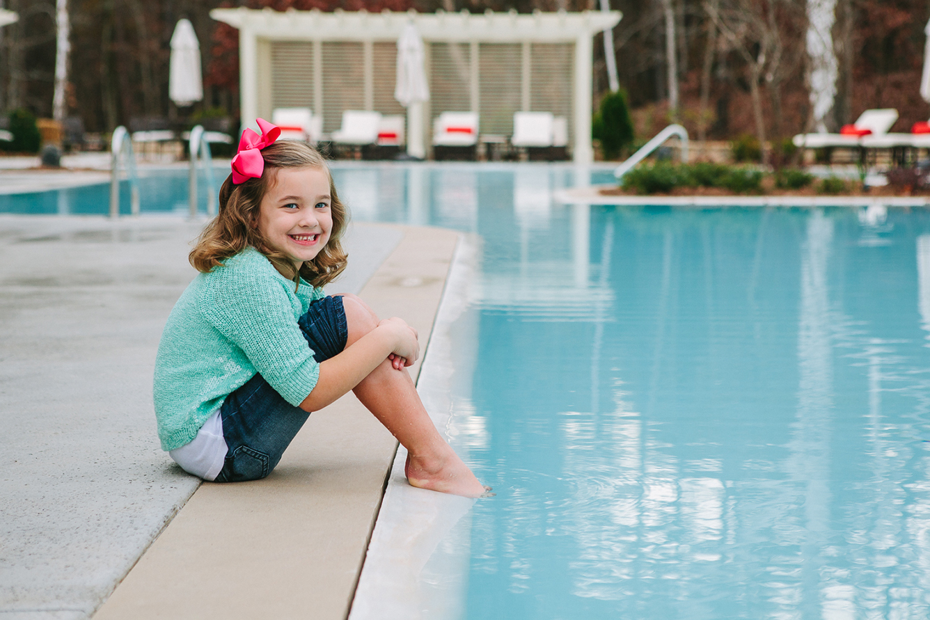 Swallowtail Flats at Old Town: Swimming Pool, Little Girl with a bow smiling