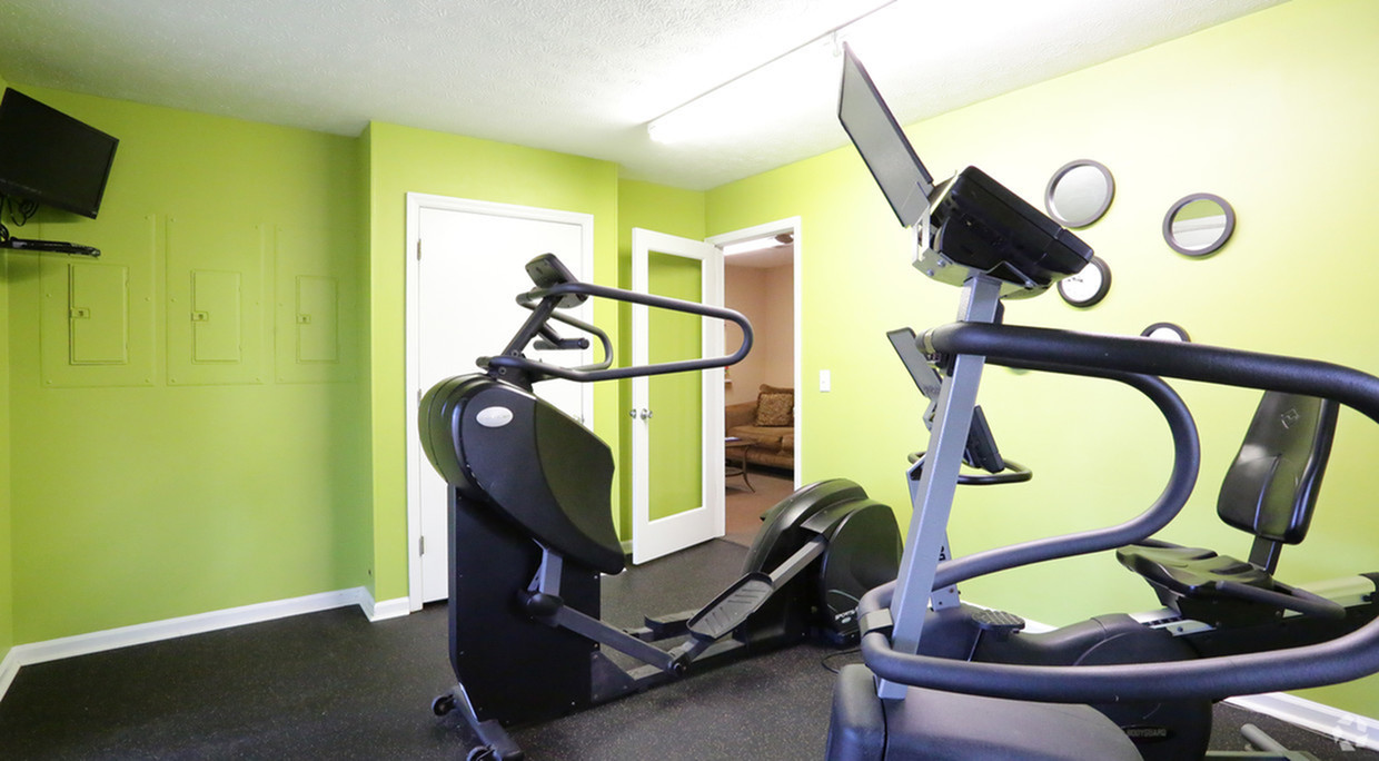 Cameron Crossing: fitness center, stair stepper, bike, TV in the corner