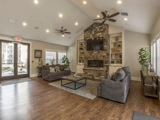 Activity Center with 1 flat screen television, 1 fireplace, 2 couches, coffee table, and open space