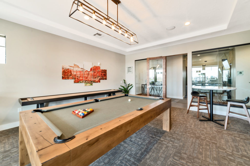 Game room with billiards table, flat screen TV, fireplace, 2 man table, and shuffleboard game table