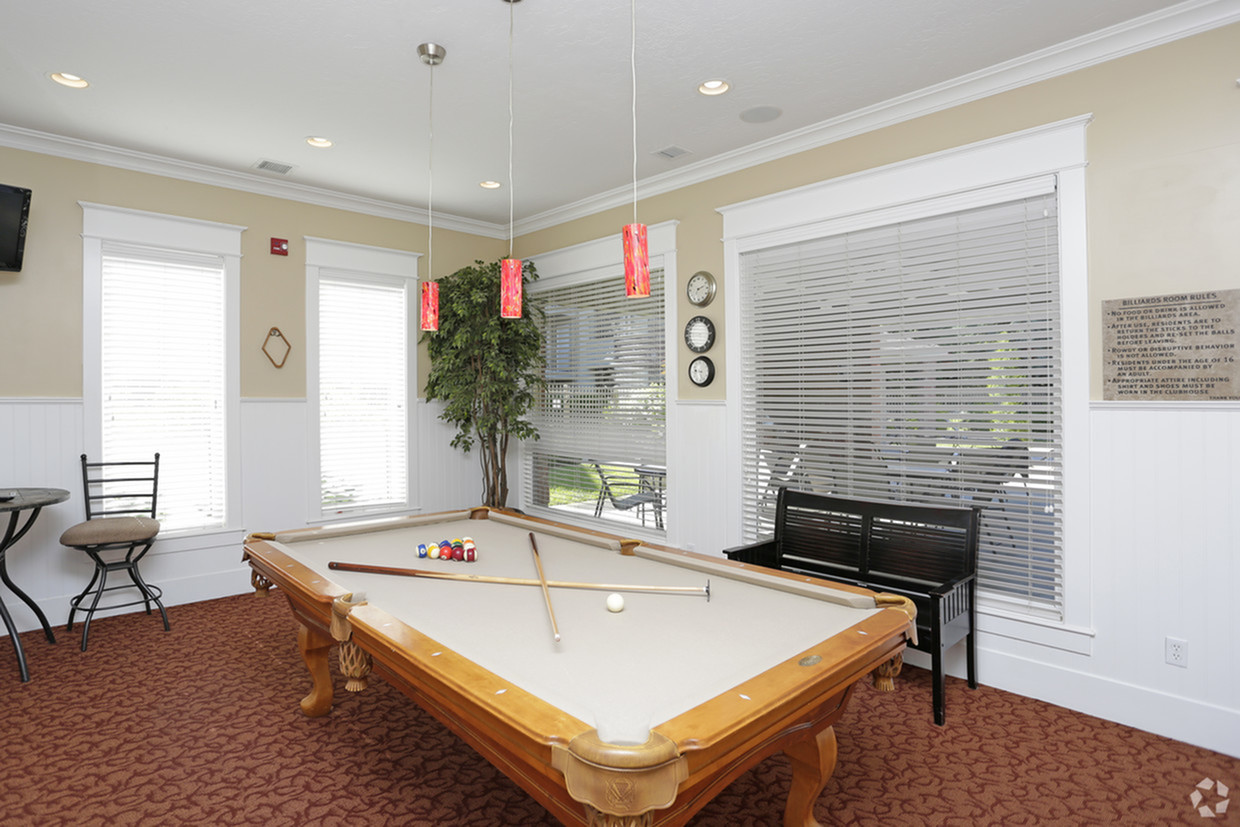 Game room with billiards table, bench, 2 man table, and television
