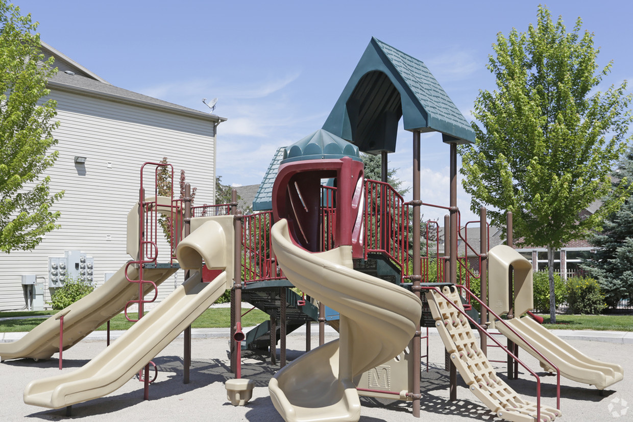 Playground structure in sand-pit with 5 slides and various climbing structures