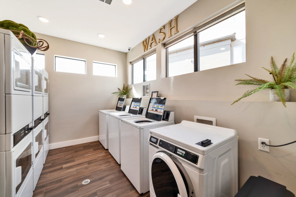 Laundry room with 4 washing machines and 6 dryers