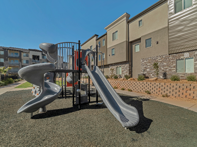 Playground with slides, small rock-climbing wall, and other play features.