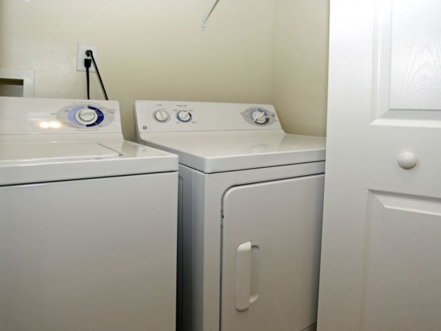 Appliances at Heritage Court include a full size washer and dryer in each apartment behind sliding doors.