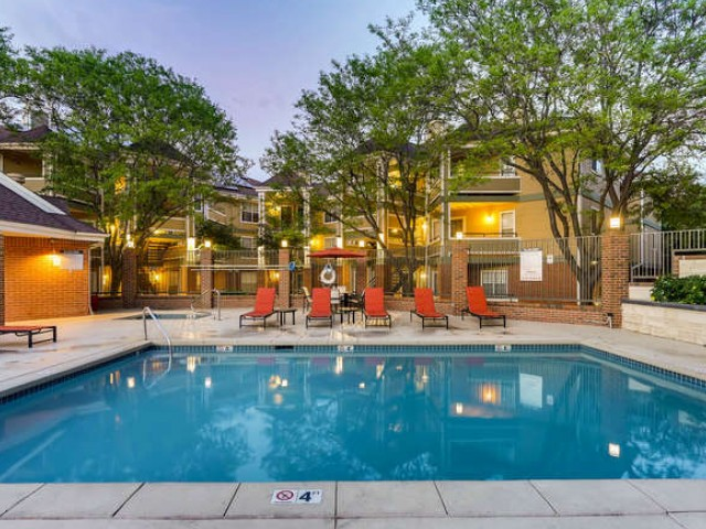 Image of Shimmering Pool with a Sundeck and Spa for Village Creek Apartments