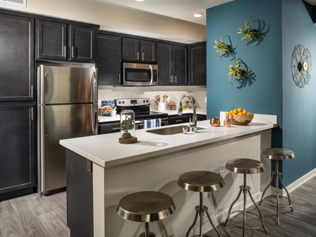 Image of Gourmet Kitchen with Island*, Quartz Style Countertops, Designer Backsplash, and Stainless Appliances for Solaire
