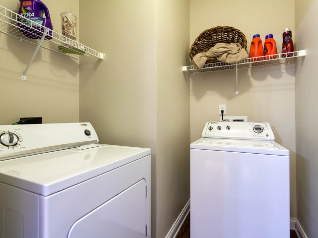 Image of Private Laundry Room Equipped With Full-size Washer and Dryer for Autumn Breeze
