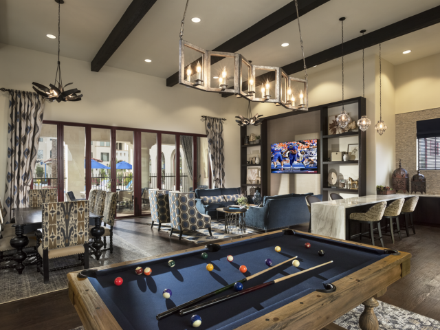 Image of Resident club house with pool tables for Almeria at Ocotillo Apartments