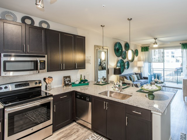 Image of Upscale kitchens featuring granite countertops, tile backsplashes, stainless steel appliances and shaker-style cabinets for Luxe Scottsdale Apartments