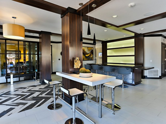 Image of Coffee bar and lounge with complimentary WiFi and a flat screen TV for Luxe Scottsdale Apartments